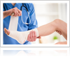 Doctor wrapping a patient's ankle with a bandage